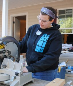 woman using circular saw