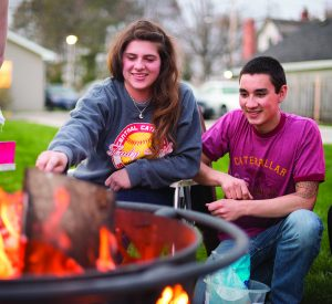 Students at a fire pit