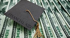 Square academic cap on top of money