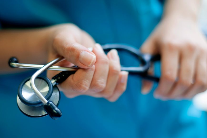 Person holding stethoscope
