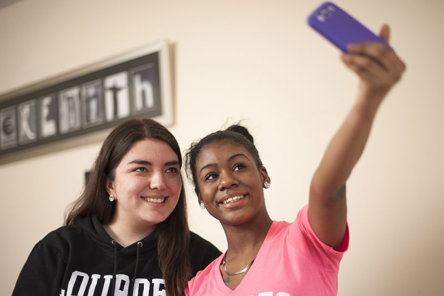 Two students taking selfie photo