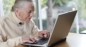 elderly person browsing the internet
