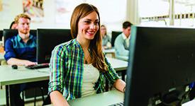 girl happy at computer
