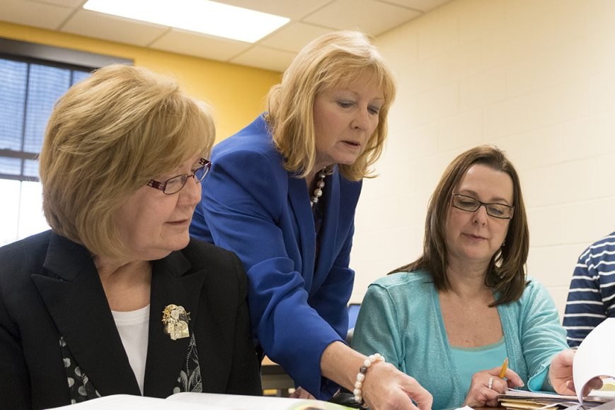 three women reviewing paperwork