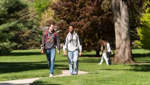 Students walking campus grounds