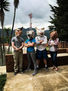 Lourdes group wearing paper mache animal masks they found
