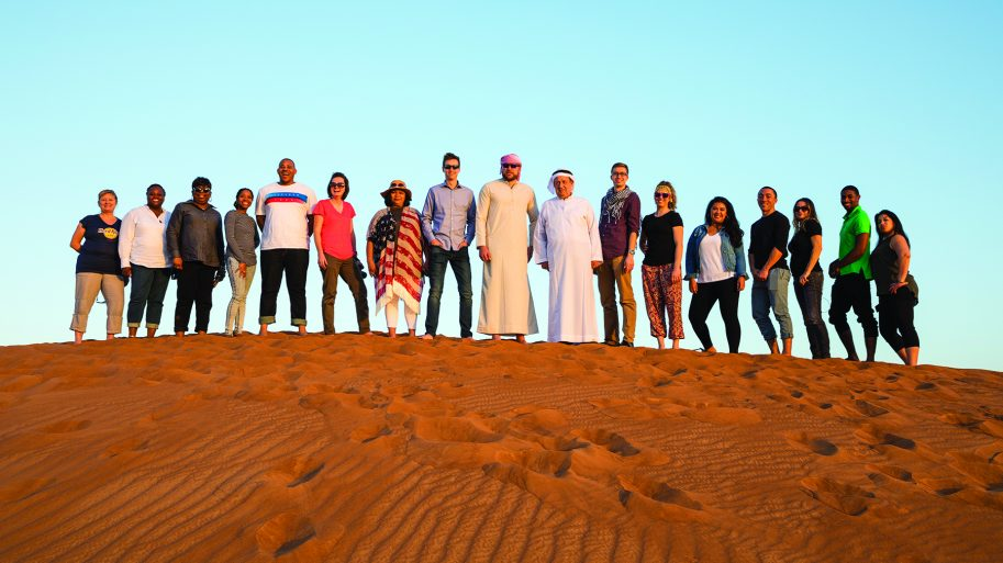 MBA and MOL Students on sand dunes during Dubai Immersion