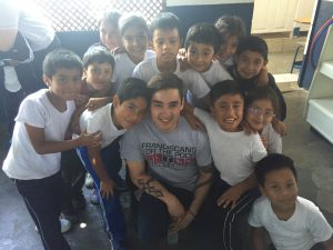 Nick posing with some of the children