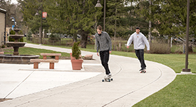Students riding on skateboards