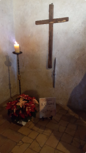 photo of cross and burning candle