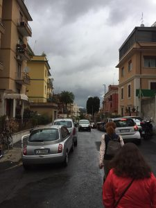 street in rome lined with buildings and cars