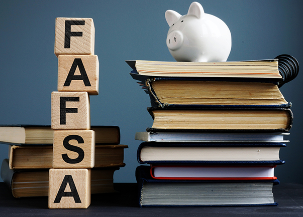 FAFSA image with piggy bank, blocks spelling FAFSA and books stacked
