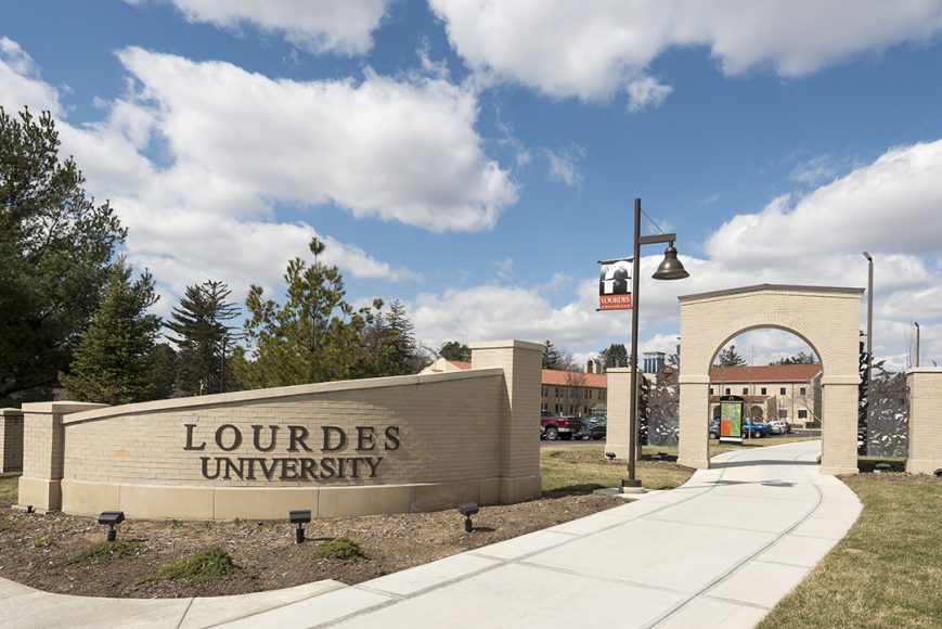 Outside of entrance at Lourdes University in summer