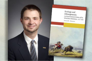 Shows history book for lecture with speaker Dr. Adam Hodge