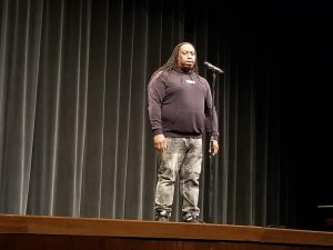 Male African American speaking on stage