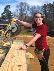 Kendra Duling using saw on Habitat project 2019