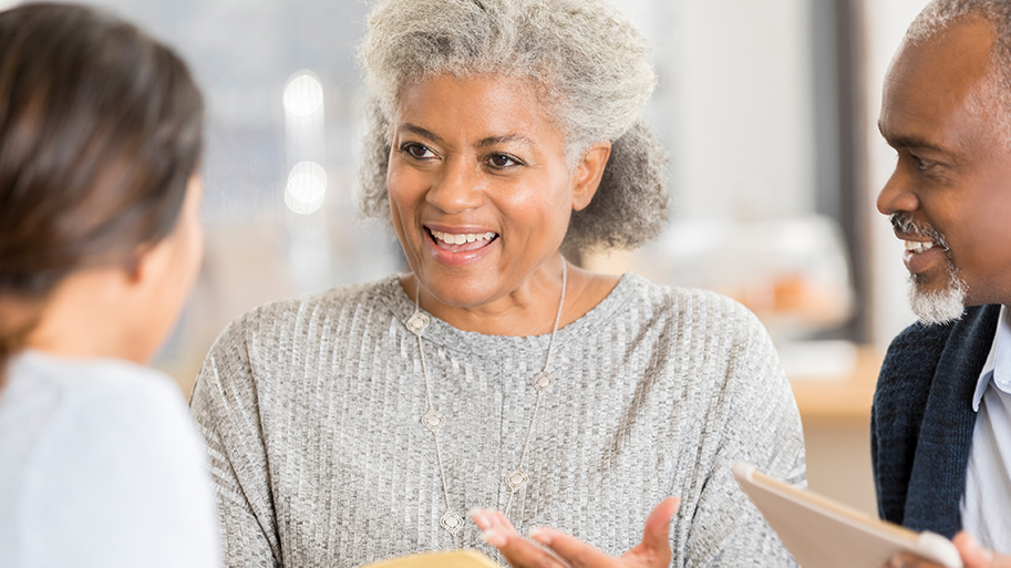Attractive Senior woman discusses something during a Bible study with colleagues.
