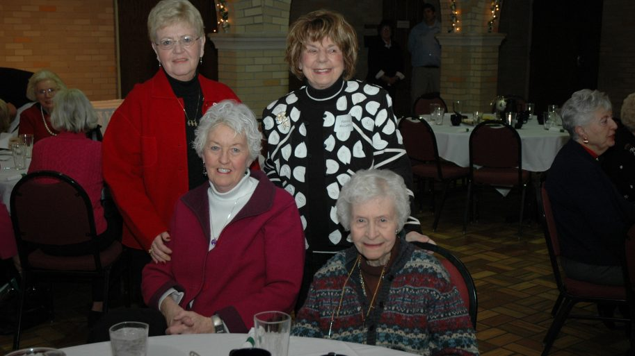 Older ladies celebrating at an elegant lunch