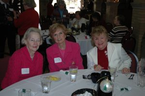 Three older ladies sitting at a table ready for an elegant lunch