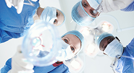 Patient's view of medical surgeons and doctors putting a patient under a general anaesthetic
