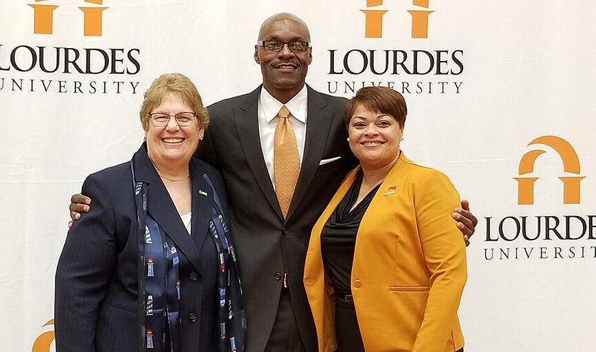 President of Lourdes University Dr. Gawelek, Men's Basketball Coach Hobson, and Athletic Director Janet Eaton