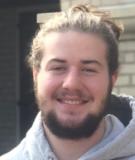 Student wearing a gray sweatshirt