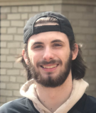 Student wearing a black cap