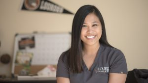 Close up of a female nursing student with a calendar in the background