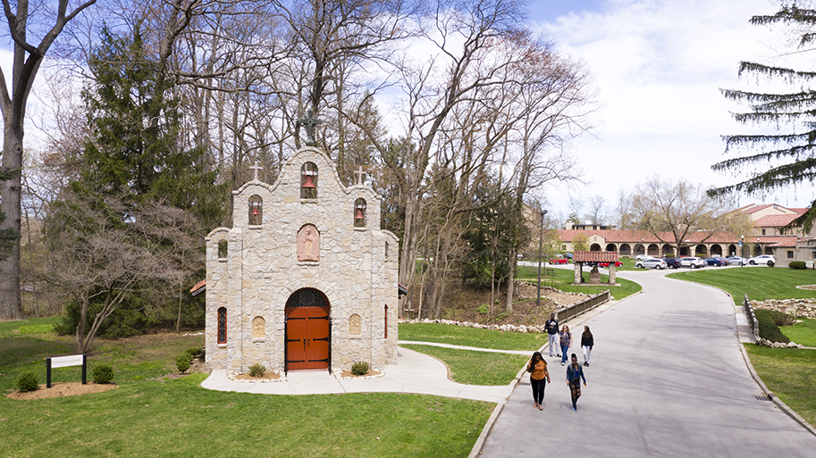 Students walking on the road next to the Sylvania Franciscan Portiuncula