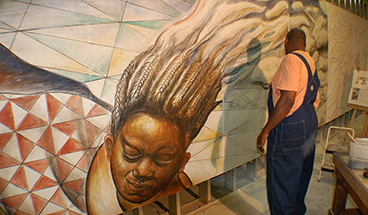 Artist Hubert Massey working