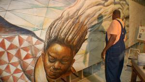Artist Hubert Massey working on a fresco mural