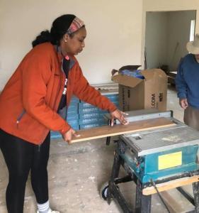 Razhane measuring and cutting wood