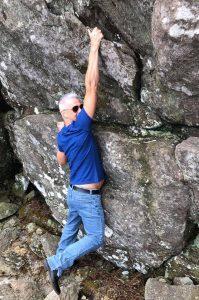 Tim Broud climbing a mountain