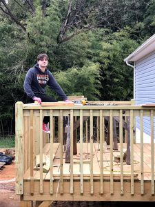 Tim Seymour working on a deck