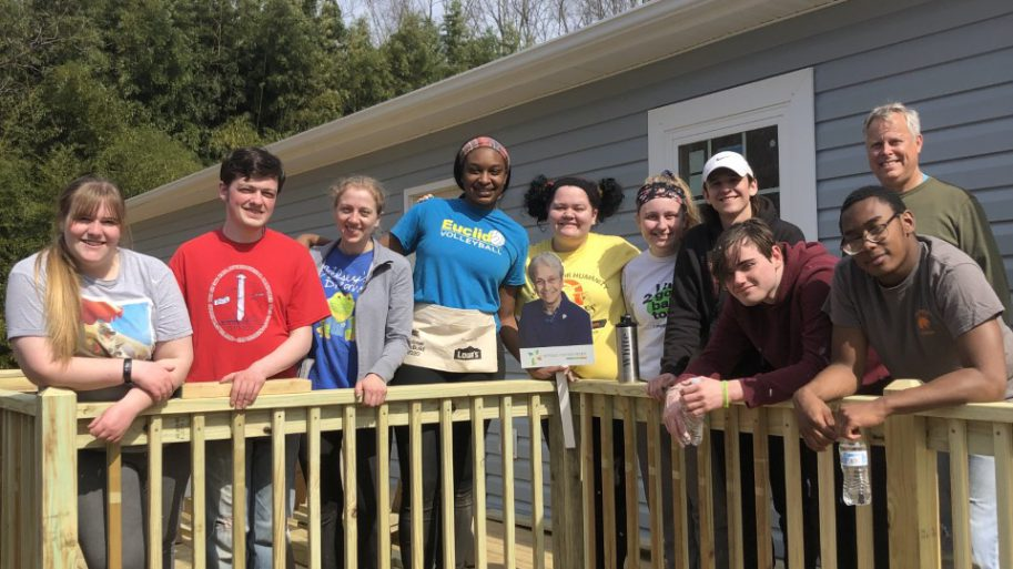 Habitat Team gathered on wooden deck