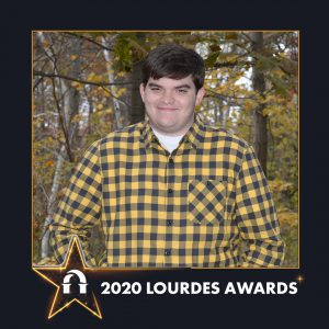 Photo of Alex Burton in 2020 Lourdes Awards frame