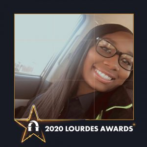Photo of Christiana Jefferson inside 2020 Lourdes Awards frame