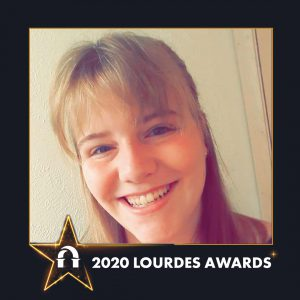 Photo of Elyse Schroeder inside 2020 Lourdes Awards frame