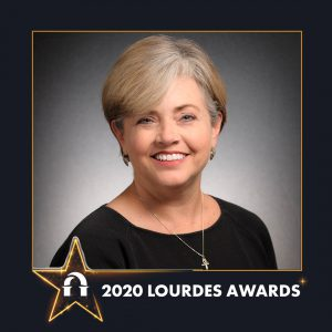 Photo of Kristin Blochowski inside 2020 Lourdes Awards frame