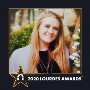 Photo of Michelle Konarzewski inside 2020 Lourdes Awards frame