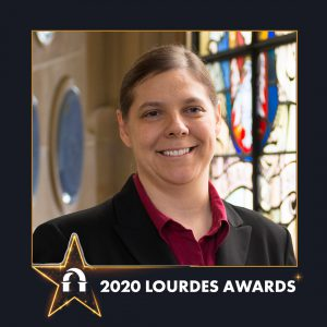 Photo of Susan Shelangoskie inside 2020 Lourdes Awards frame