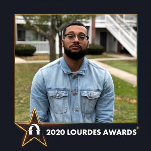 Photo of Carlos Echevarria inside a 2020 Lourdes Awards frame
