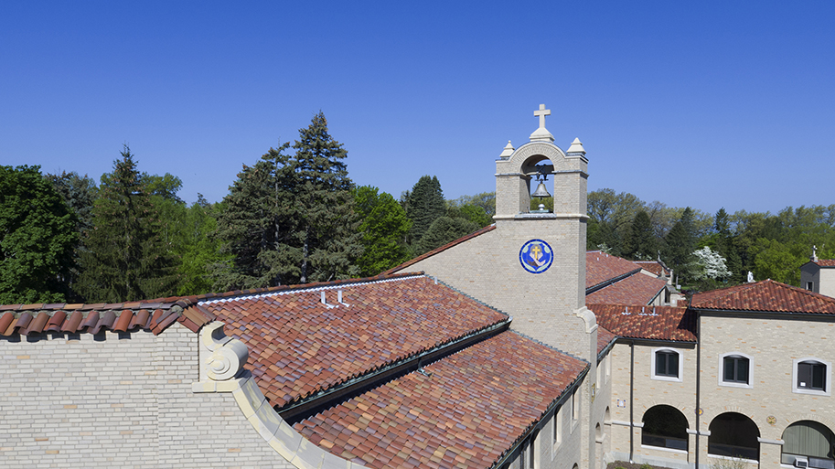 Photo of Lourdes campus building from an aerial view with terra cotta tile roof and bell tower