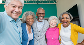 Diverse Group Of Seniors Smiling Together With Arms Around Each Other And Smiling