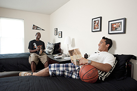 Students relaxing in their apartment-style campus digs