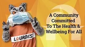 Lourdes University mascot wearing face covering