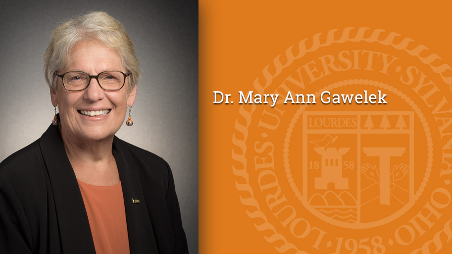 Image of President Mary Ann Gawelek's photo with the seal and her name