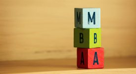 An image of three building blocks stacked that read M, B, A