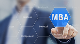 Individual pointing to interactive screen and highlighting the word MBA