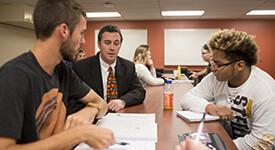 Education professor teaching students